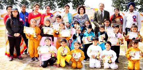 Students posing alongwith dignitaries while celebrating Annual Sports Day at Kindergarten of Heritage School in Jammu.
