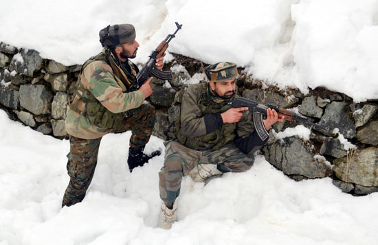 Troops in action against militants at Sopore on Saturday.
