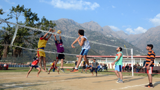 Players in action during a final match of Volleyball Tournament at Shrine Board's Sports Complex at Katra.