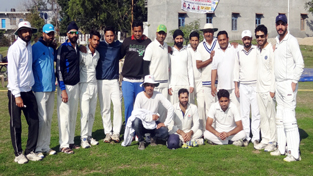Jubilant Simula Cricket Club Players posing for a group photograph after registering win in Chief Minister's Cup at Gharota in Jammu.