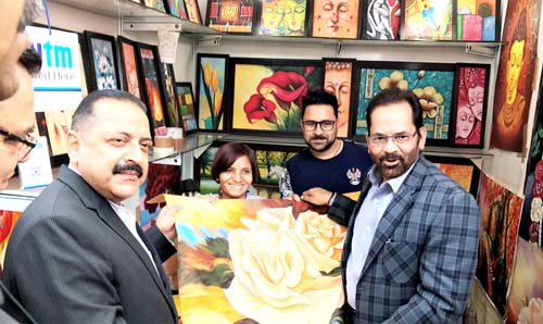 "Union Minister Dr Jitendra Singh going around the various stalls of ""Hunar Haat"", accompanied by Union Minister Mukhtar Abbas Naqvi who heads the Ministry of Minority Affairs which has organized the 15-day festival, at New Delhi on Monday."