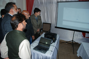 Finance Minister Dr Haseeb Drabu and Forest Minister Lal Singh launching 'Easy Collect' at Lakhanpur on Wednesday.