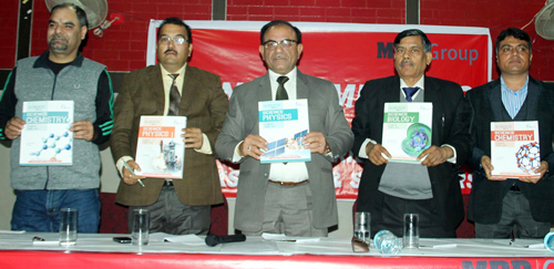 MBD Group top executives releasing a new book during distributors & book sellers meet at Jammu on Sunday.