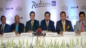 Raj Rana, CEO, South Asia, Carlson Rezidor Hotel Group interacting with media persons at Jammu on Monday. —Excelsior/Rakesh