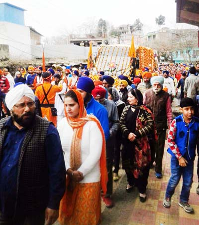 Impressive Shobha Yatra being taken out by Sikh community members at Poonch on Tuesday. -Excelsior/ Harbhajan
