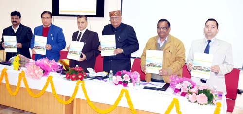 Guests releasing abstract booklet during inaugural of conference at SMVDU on Monday.