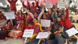 Contractual Lecturers sitting on chain hunger strike at Jammu on Saturday.