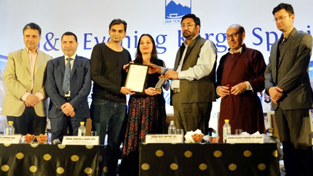 Chairman J&K Legislative Council Haji Anayat Ali presenting an award at OTM Mumbai on Friday.