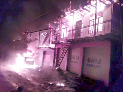 Residential complex and a car in flames at Malik Pura market in Tehsil Gandoh. -Excelsior/Tilak Raj