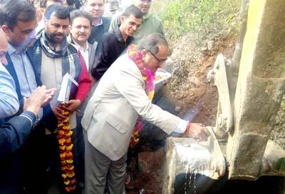 Deputy Chief Minister Dr Nirmal Singh kick starting development work at Billawar on Tuesday.