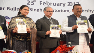Minister for Industries, Chander Prakash Ganga and others releasing Placement Brochure for MBA (IB) and ICccR & HRM during a discussion on 'Make in India, Make in J&K' at JU on Thursday.