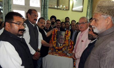 National Conference Provincial President Devender Singh Rana and others paying floral tributes to Sheikh Nazir Ahmed on Saturday.