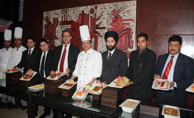 Chefs and officials of Hotel K C Residency showing cuisines to be served during Royal Food Festival 'Jewels of India'. -Excelsior/Rakesh