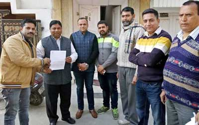 MLA Jammu West, Sat Sharma handing over a letter pertaining to release of Rs 1.5 lakh from CDF to BJYM vice President Ajay Vaid on Thursday.