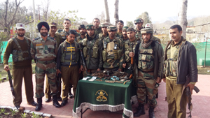 Security personnel pose with recoveries at Mendhar on Wednesday.