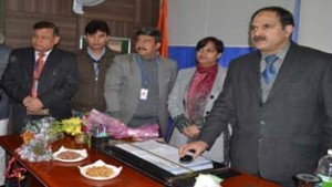 Registrar Cooperative Societies, BA Bhat launching website of the Citizens' Cooperative Bank Ltd. on Friday.