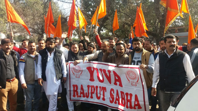 Members of Yuva Rajput Sabha holding protest in front of Press Club of Jammu on Wednesday.