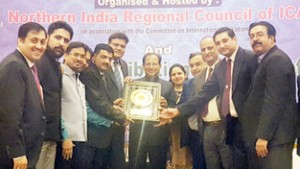 Office bearers of ICAI, Jammu and Kashmir Branch receiving 'Best Branch' award at New Delhi.