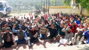 Medical employes raising slogans in support of their demands during a protest dharna at Rajouri.