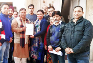 MLA Jammu West handing over a letter for ambulance to authorities of Government Hospital Sarwal on Monday.