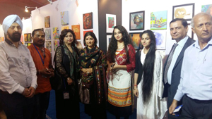 Artists from J&K posing for photograph during the ongoing 41st International Annual Khajuraho Dance Festival and Art Mart.