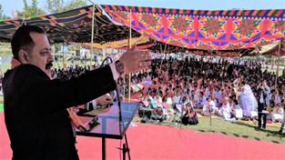 Union Minister Dr Jitendra Singh addressing a mammoth election rally, at Wabagai in Manipur on Friday.