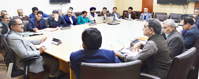 Deputy Chief Minister Dr Nirmal Singh chairing a meeting at Jammu on Friday.