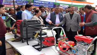 Minister for Industries and Commerce, Chander Parkash Ganga inspecting a stall at Kissan Mela at Samba on Saturday.