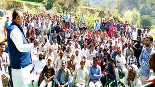 Minister for Industries and Commerce Chander Parkash Ganga addressing a public gathering on Sunday.