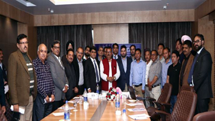 Minister for Industries and Commerce Chander Parkash Ganga and officials of CII posing for group photograph after launch of Ladakh Zonal Council.