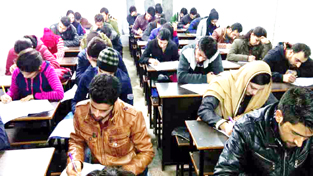 KAS aspirants appearing in Full Mock Test conducted by SR College of Competitions at Jammu on Sunday.
