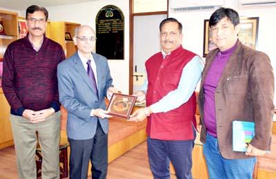 Dr Ramesh Ganju being presented a memento by SMVDU VC.