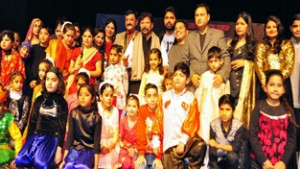 Minister for Forest Choudhary Lal Singh with participants of talent hunt show at Jammu on Saturday.