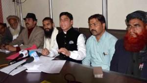 Kalakote People's Forum president, Surinder Singh, flanked by others addressing press conference in Jammu. — Excelsior/Rakesh