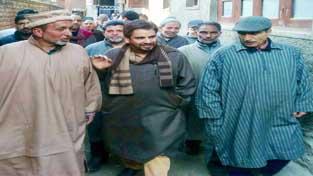 NC leaders touring Srinagar city on Saturday.
