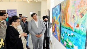 Usha Vohra, First Lady viewing art works at Kala Kendra in Jammu on Saturday.