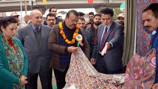 Industries Minister C P Ganga inspecting stall at Handloom Expo on Saturday.
