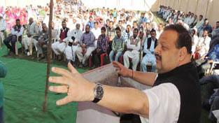 MLA Nagrota & Provincial President National Conference Devender Singh Rana addressing a gathering at Nagrota on Thursday.