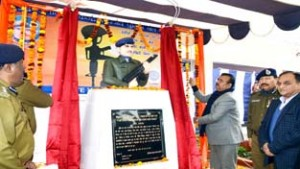 Minister for Industries and Commerce Chander Parkash Ganga unveiling the bust of CRPF Constable Naresh Kumar on Friday.