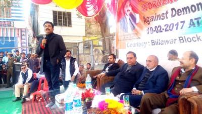 Senior Cong leader Dr Manohar Lal Sharma addressing public rally at Billawar on Friday.