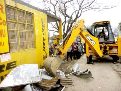 An encroachment being removed at Transport Nagar.