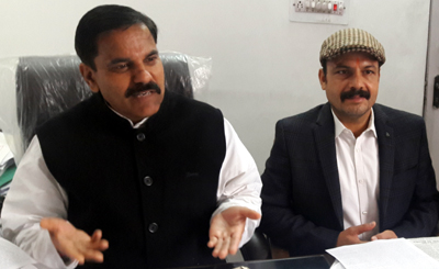 NPP leaders Harsh Dev Singh and Balwant Singh Mankotia addressing press conference in Jammu on Wednesday.