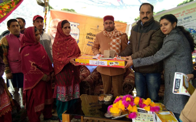 MLA Ramban Neelam Kumar Langeh distributing LPG connection to a beneficiary at Assar on Wednesday.