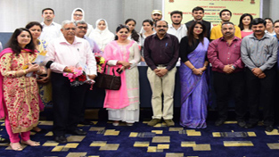 Participants of seminar posing for group photograph.
