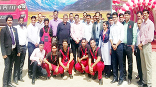 Staff of Astro India Automobile Pvt Ltd during opening of 2 bay Mahindra & Mahindra set up in Jammu.