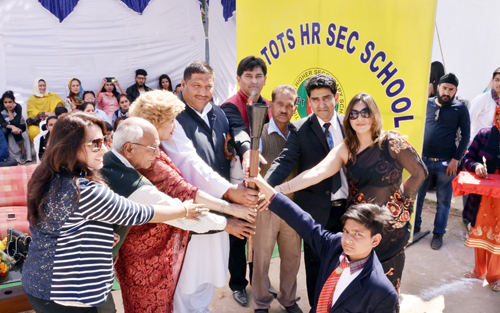 Dignitaries and participants lighting torch during Sports cum annual day celebration at Tiny Tots in Jammu.