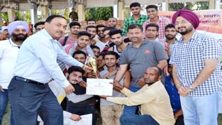 Athletes being felicitated by IGP Jammu S D Singh Jamwal and Simrandeep Singh, Deputy Commissioner Jammu on Sunday.