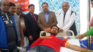 Minister of State for Finance and Planning, Ajay Nanda and others during a blood donation camp.