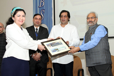 Sajad Gani Lone, Minister for Science & Technology presenting memento to a participant during valedictory function of international conference at JU on Saturday.
