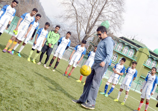 27524ffac3 PDP s Anantnag constituency candidate Tasaduq Mufti playing football with  Khelo  India Khelo  football players at Pologround in Srinagar on Friday.